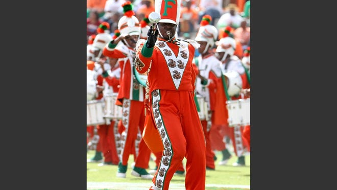 Florida A&M Marching 100 Drum Major Robert Champion performs in 2011. Champion was killed in November 2011 after a hazing ritual aboard a bus in an Orlando hotel parking lot.