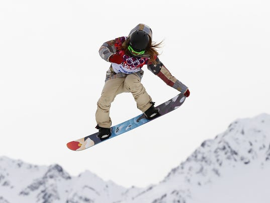 Winner Jamie Anderson of the U.S. jumps during the women's snowboard slopestyle finals event at the 2014 Sochi Winter Olympics in Rosa Khutor