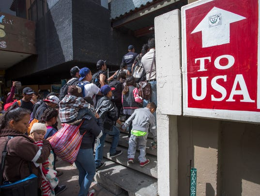 Migrants In Caravan That Travelled Through Mexico Attempt To Be Granted Asylum At U.S. Border