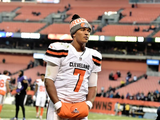 """FILE - In this Dec. 17, 2017, file photo, Cleveland Browns quarterback DeShone Kizer walks off the field after the Baltimore Ravens defeated the Browns 27-10 in an NFL football game in Cleveland. They're two losses away from a winless season, and quarterback DeShone Kizer acknowledged the possibility is weighing on him. """"You definitely feel it,"""" he said. The Browns play the Bears  on Sunday. (AP Photo/David Richard, File)"""
