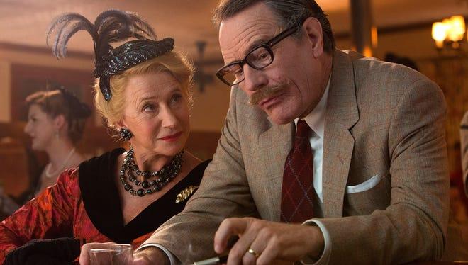 "Gossip columnist Hedda Hopper (Helen Mirren) gets inquisitive with screenwriter Dalton Trumbo (Bryan Cranston) in ""Trumbo."""