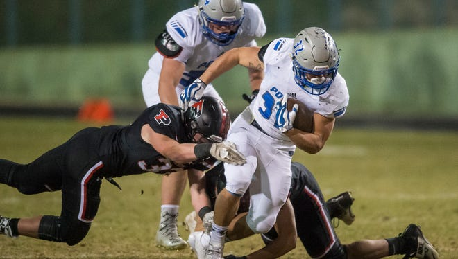 Powder High School running back JT Erickson finds running room against the Pomona Defense on Friday, Nov. 10, 2017, at the North Area Athletic Complex in Arvada, Colo.