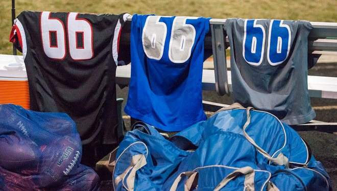 The jerseys of junior defensive lineman Josh Cortez are hung on the Poudre High School bench in honor of him during a game against Pomona High School on Friday, Nov. 10, 2017, at the North Area Athletic Complex in Arvada, Colo.