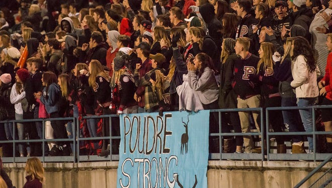 """A sign reading """"Poudre Strong"""" in honor of Poudre junior defensive lineman Josh Cortez is hung on the Pomona High School student section on Friday, Nov. 10, 2017, at the North Area Athletic Complex in Arvada, Colo."""