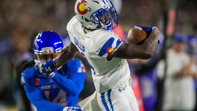 CSU receiver Michael Gallup (4) stiff arms his way past Boise State cornerback Tyler Horton (14) for  first down during the first quarter of play, Saturday, Nov. 11, 2017, at CSU stadium in Fort Collins, Colo.