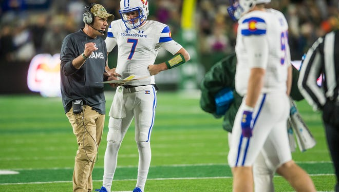 CSU coach Mike Bobo talks to quarterback Nick Stevens during a timeout in the second quarter of Saturday night's game against Boise State. Despite building big leads early, the Rams lost 59-52 in overtime, making a third straight 7-5 season likely.