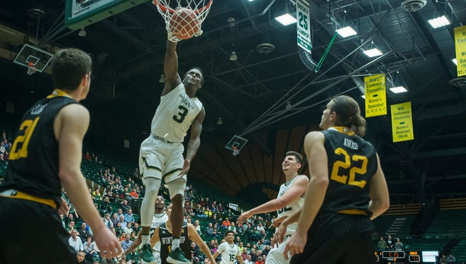CSU's Raquan Mitchell dunks during a Nov. 14 game against Winthrop at Moby Arena. Mitchell took an unusual path from the streets of Miami to CSU.