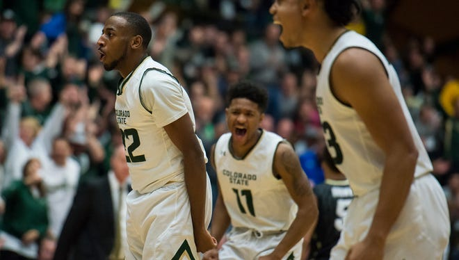 CSU guard J.D. Paige (22) and teammates Prentiss Nixon (11) react after a dunk by Paige during the Rams' 72-63 win Saturday over Colorado at Moby Arena.