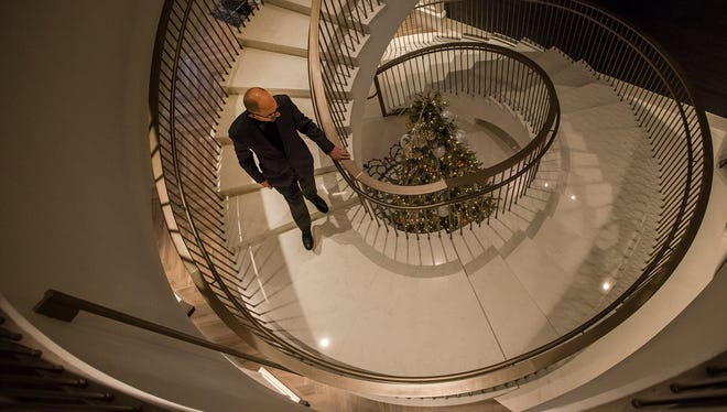 General Manager Scott Sloan walks down the spiral staircase leading to the main lobby while giving a tour of the hotel on Monday, Dec. 4, 2017, before the soft-opening of the Elizabeth Hotel in Old Town Fort Collins, Colo.