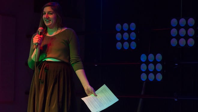 Coloradoan arts, entertainment and culture reporter Erin Udell tells her story on Thursday, Dec. 14, 2017, during The Coloradoan's Storytellers Project at The Downtown Artery in Fort Collins, Colo.