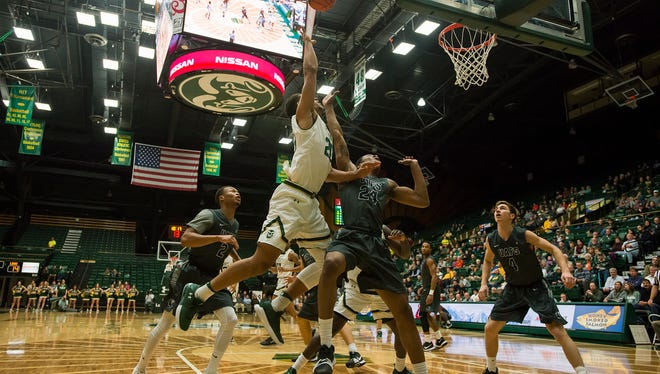 CSU junior forward Deion James (20) goes for a layup over Arkansas-Fort Smith freshman guard Jeremiah Toney (24) on Tuesday, Dec. 19, 2017, at Moby Arena in Fort Collins, Colo.