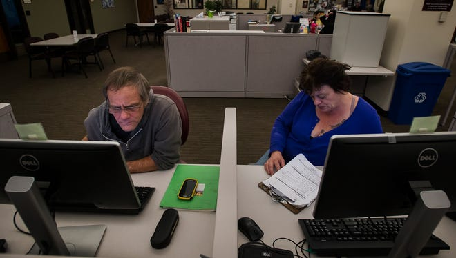 Harold and Sharon Talbert use computers at the Larimer County Workforce Center to search for a job on Friday, Jan. 5, 2018. Talbert had worked as an auto body painter, but he and his wife are currently looking for any work they can find.