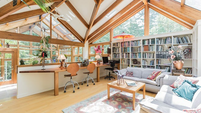 The Thyrums added a greenhouse conservatory that flows into a dining area, which in turn is overlooked by a library.