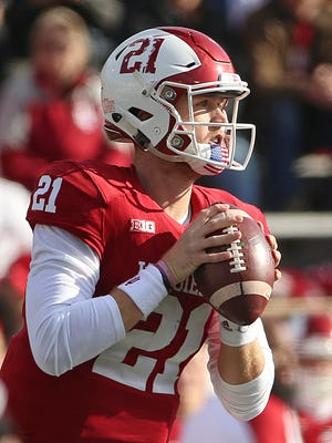 Indiana Hoosiers quarterback Richard Lagow (21) looks for an open receiver during first half action of the Oaken Bucket game between Purdue and Indiana at Memorial Stadium, Bloomington, Ind., Saturday, Nov. 26, 2016.