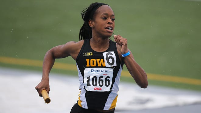 Iowa sophomore Elexis Guster runs the baton in the 1,600 meter sprint medley event during the Drake Relays at Drake Stadium in Des Moines in 2015.