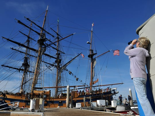 Silver Strand resident Mary Ann George (right) photographs the tall ship Hawaiian Chieftain as it and the Lady Washington were at the Channel Islands Harbor dock in 2014.