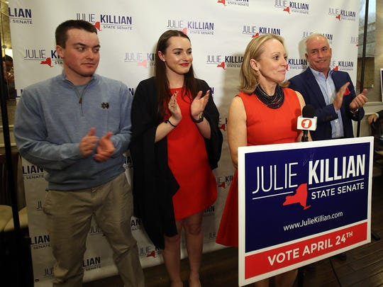 Republican Julie Killian, flanked by her family, thanks