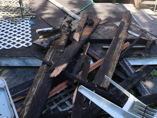 Scraps of burnt wood sit outside of the complex on Eastman Terrace. Firefighters responded to reports of a fire at around 11:30 a.m.