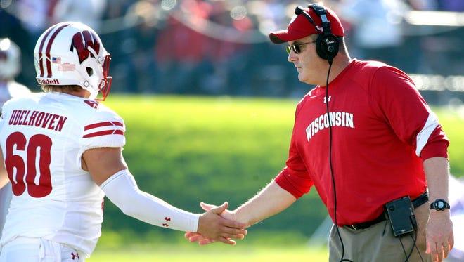 Wisconsin football coach Paul Chryst congratulates long snapper Connor Udelhoven.