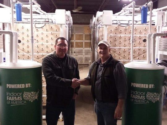 Dave Martin congratulates Jay John in the Salamanca New York Indoor Farm.