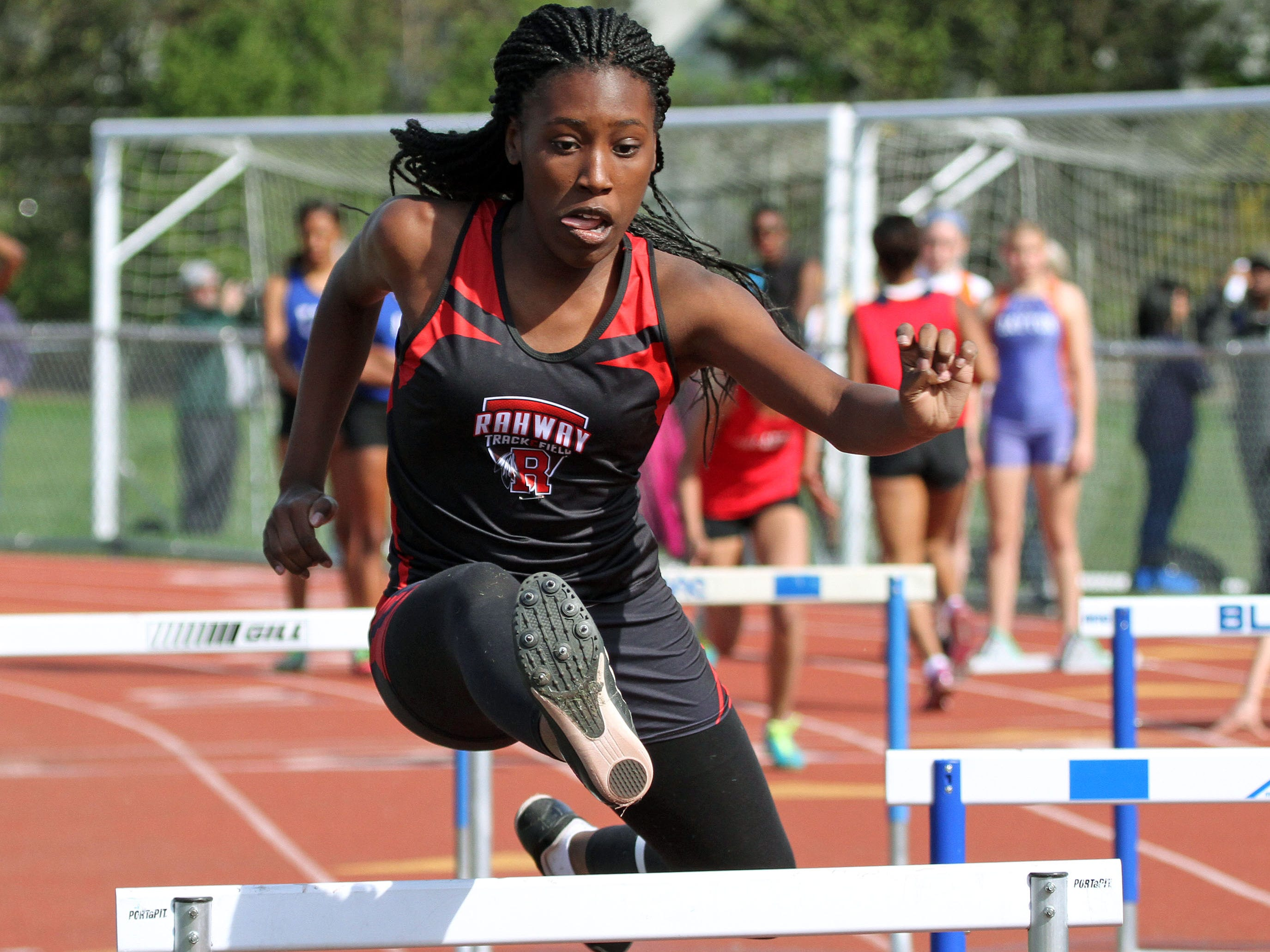 Rahway's Najah Hetsberger runs the thrid leg of her team's shuttle hurdles. This is action of the Union County Track and Field Relays.