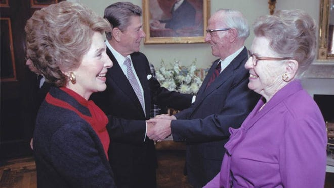 Walter Judd and his wife, Miriam, are greeted by President Reagan, and first lady Nancy, at 1981 ceremony for Presidential Medal of Freedom.