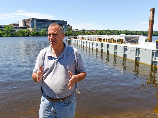 Tom Richardson, fireworks commissioner, checks on the progress of the fireworks barge on July 3, 2017, at Wilson Park.