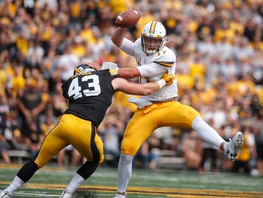Wyoming quarterback Josh Allen tries to escape from