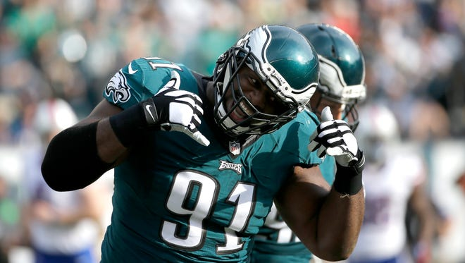 Philadelphia Eagles' Fletcher Cox reacts after a sack during the first half of an NFL football game against the Buffalo Bills, Sunday, Dec. 13, 2015, in Philadelphia.
