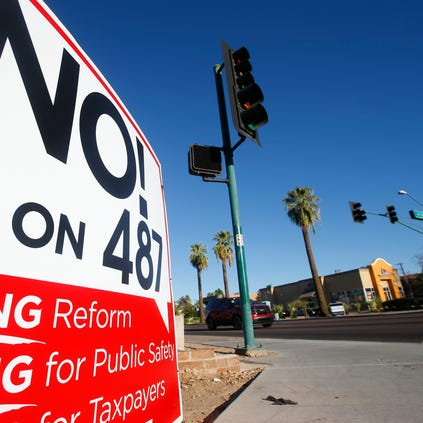 A Proposition 487 sits on the corner of McDowell and 3rd St. on Sunday, Sept. 14, 2014.
