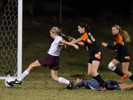 Darby Onan of Henderson County breaks through the Hopkinsville defense to score a goal during the first half of the girls Second Region championship at Colonel Field in Henderson Thursday.  The Colonels won 4-0.