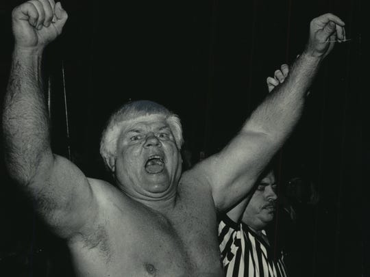 The Crusher celebrates after winning a match.