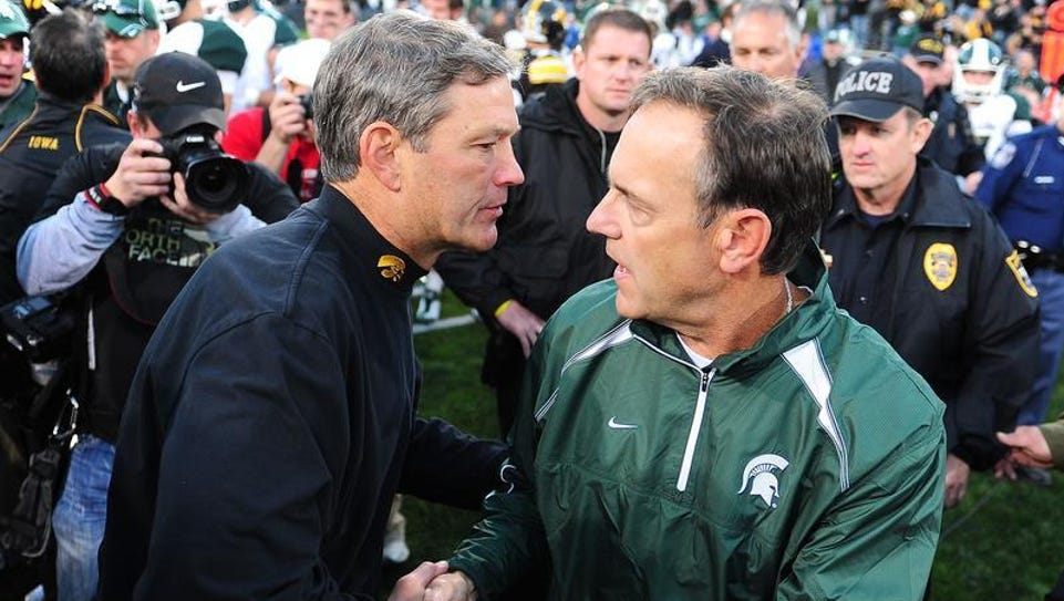 Iowa Hawkeyes head coach Kirk Ferentz (left) shakes