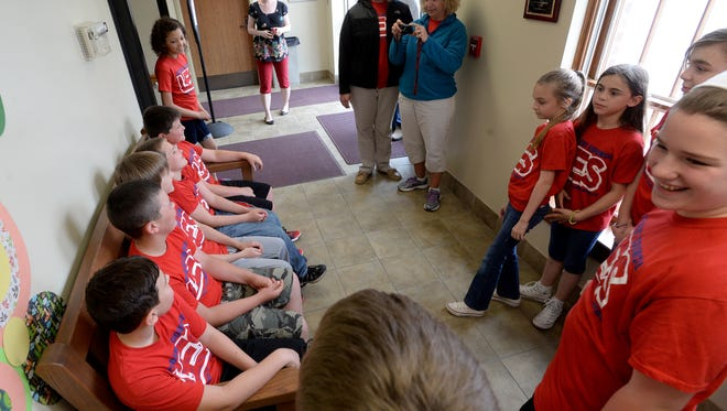 The Liberty Elementary Student Council, with the help of a matching donation, raised about $500 to have a hand-crafted wooden bench built for the Union County Library Wednesday, April 27, 2016 in Liberty.