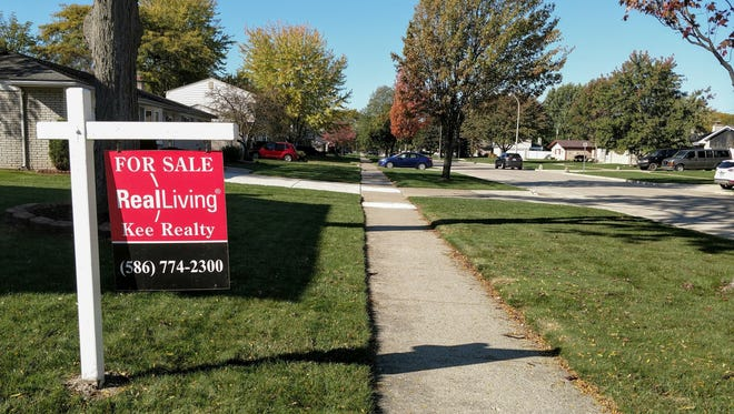 """A """"For Sale"""" sign in front of a home on Lyndon in Livonia. A real estate website recently listed the 48154 ZIP Code in the city as one of the hottest real estate markets in the country."""