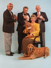 1996: From left: WKRC-TV's John Lomax, DJs Dave Mason and Bobbi Maxwell and SPCA President Harold Dates promote a pet adoption telethon.