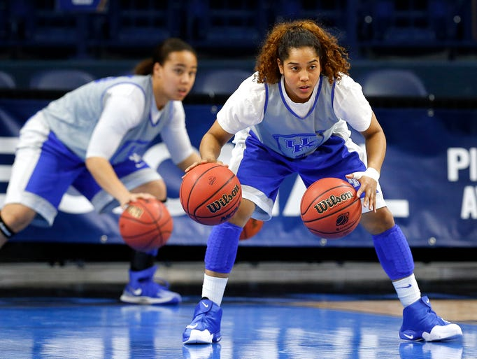 Kentucky guards Jennifer O'Neill, right, and Makayla Epps practice dribbling during their NCAA women's college basketball tournament practice at the Purcell Pavilion in South Bend, Ind., Friday, March 28, 2014. Baylor plays Kentucky Saturday. (AP Photo/Paul Sancya)