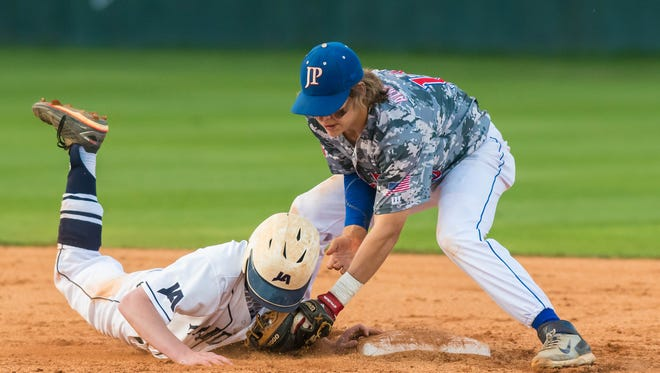 Jackson Prep shortstop Chance Lovertich tries to pick off Jackson Academy's Ben McDowell during the opening game of a MAIS AAAA baseball playoff series on Tuesday. Prep won 15-6.