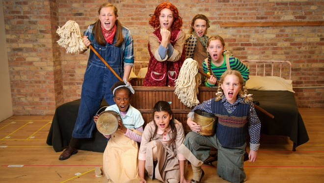 "The young cast members of Skylight Music Theatre's ""Annie"" include (clockwise from left) Avery Holmes (with mop), KyLee Hennes (as the red-haired Annie), Lorelei Wesselowski, Phinlee Clarkin, Paisley Schroeder, Taylor Arnstein and Taressa Hennes."