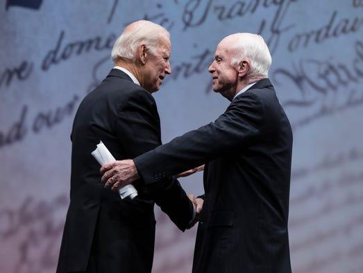 Sen. John McCain, R-Ariz., shakes hands with Biden