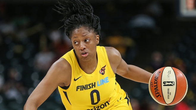 Indiana Fever guard Kelsey Mitchell (0) works a possession during first half action at Banker's Life Fieldhouse in Indianapolis, Tuesday, June 12, 2018.