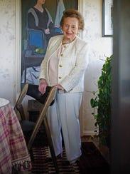 Libby Zurkow wears a pale multicolored weave jacket