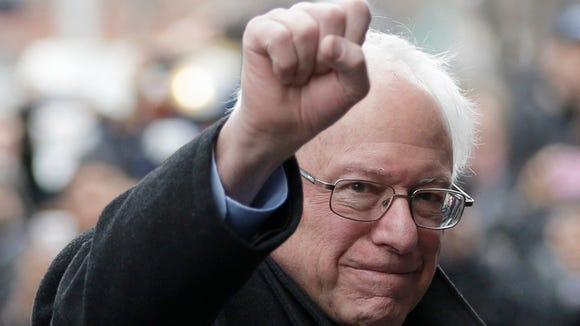Bernie Sanders raises a fist as he arrives for a breakfast meeting with Al Sharpton in New York on Feb. 10, 2016.