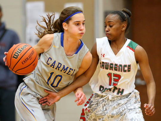 Lawrence North's Lauren Dickerson (right) and Carmel's Amy Dilk (left) are a big reason their teams won sectional titles.