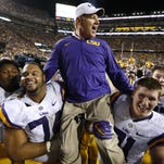 LSU head coach Les Miles is carried off the field after an NCAA college football game against Texas A&M in Baton Rouge, La., Saturday, Nov. 28, 2015. LSU won 19-7. (AP Photo/Jonathan Bachman)