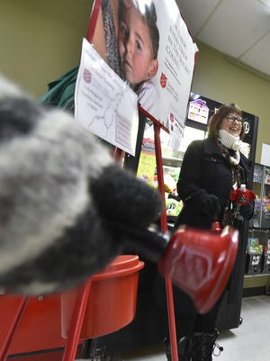 Marna Nejedlo works The Salvation Army red kettle on Dec. 14 at Tadych's Econo Foods in Sturgeon Bay. Nejedlo and Amanda Wilson, both of Sturgeon Bay, were volunteering on behalf of Door County Coffee & Tea. A portion of the Red Kettle drive aids the homeless in the county.