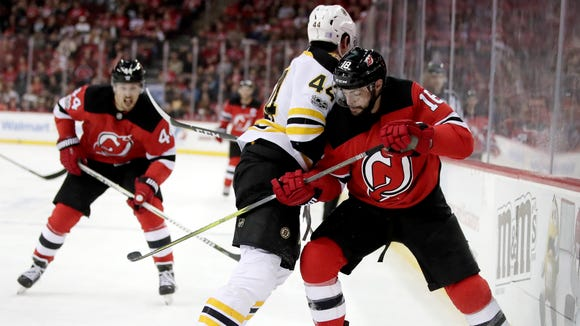 Boston Bruins defenseman Rob O'Gara (44) and New Jersey Devils right wing Drew Stafford (18) compete for the puck during the second period of an NHL hockey game, Wednesday, Nov. 22, 2017, in Newark.