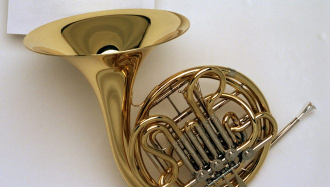 But will it fit in the overhead? New rules take effect March 6 regarding transport of musical instruments — including French horns — on airlines.