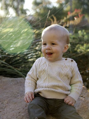 15-month-old Logan Connor Schmidt, of Gilbert, died Wednesday, Dec. 23, 3015, from complications of a cold.