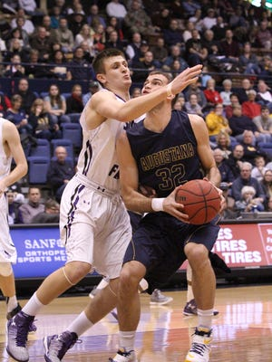 Casey Schilling of Augustana looks to shoot as Tom Aase of USF defends on Saturday at the Arena. Casey Schilling of Augustana looks to attempt a shot as Tom Aase of USF defends during Saturday night's game at the Arena.